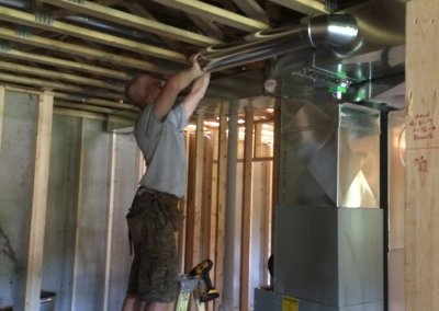 Hanging ductwork in a new construction home.